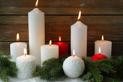Xmas candles and green branches Stock Photo