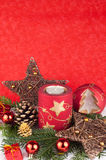 Xmas candles on red background. Red christmas candles and xmas balls in snow on red background Royalty Free Stock Photo