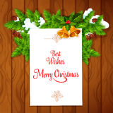 Xmas card with holly berry on wooden background Royalty Free Stock Photography
