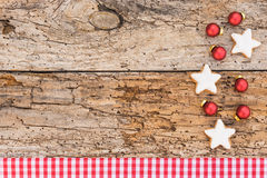 Xmas card with star cookies and christmas balls Stock Photos