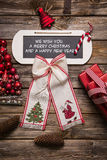 Xmas card: We wish you a merry christmas and a happy new year. Red and white decoration with wood in country style Royalty Free Stock Images