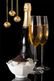 Xmas caviar. Champagne glasses and caviar with christmas bells Stock Image