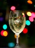 Xmas Celebration. Xmas drinks beside the tree. Cheers stock photos