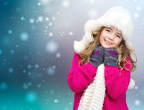 Xmas child girl winter clothes on snowy background. Royalty Free Stock Photo