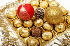 Xmas chocolate gift. With christmas bauble on the white background Royalty Free Stock Photos