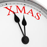 Xmas on a clock Royalty Free Stock Images
