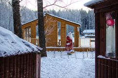 Xmas, cold, December. Santa Claus going with a bag of gifts in the winter on snow-covered field. N royalty free stock image