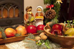 Xmas composition with figures, apples and needles Royalty Free Stock Photography
