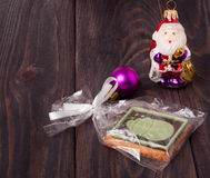 Xmas cookie with colored candies on wooden background Stock Photos