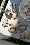 Xmas cookies on baking tray Stock Photography