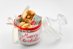 Xmas cookies in glass jar with Christmas decoration. Selective focus Stock Images