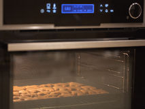 Xmas cookies in the oven. Traditional xmas dessert royalty free stock image