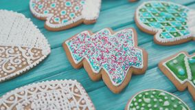Xmas cookies in the shape of a heart, mitten. Confectionery sprinkle stock footage