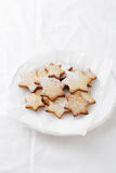 Xmas cookies on white plate Stock Images