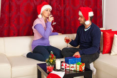 Xmas couple drinking wine Royalty Free Stock Photography