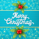 Xmas 3d lettering and holly on blue background. Stock Photo