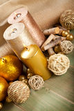 Xmas decor. Golden candles and baubles Royalty Free Stock Images