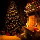 Atmospheric decorated fireplace with christmas tree stock photography