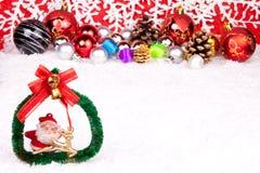 Xmas decoration. Xmas coronet on snow with xmas balls in background Stock Photos
