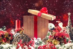 Christmas background concept. Shimmering Christmas decorations with gift, tree, Santa Claus and candles. Xmas decoration background with balls for xmas tree and royalty free stock photos