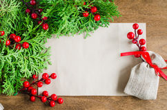 Xmas decoration with blank postcard on wooden background. Merry christmas. Selective focus, space for text. Royalty Free Stock Photos