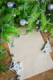 Xmas decoration with blank postcard on wooden background. Selective focus, space for text. Stock Photo