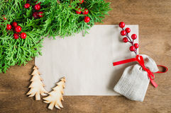 Xmas decoration with blank postcard on wooden board. Selective focus, space for text. Stock Image