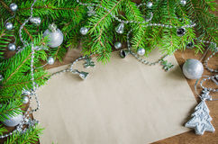 Xmas decoration with blank postcard on wooden board. Selective focus, space for text. Royalty Free Stock Photos
