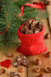 Xmas decoration with chocolate biscotti and pine twigs Royalty Free Stock Photo