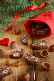 Xmas decoration with chocolate biscotti and pine twigs Royalty Free Stock Image