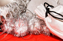 Xmas decoration with gift bag. On a red cloth Royalty Free Stock Images