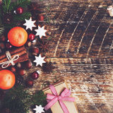 Xmas decoration with gift box, cinnamon, gingerbread cookies Royalty Free Stock Photography