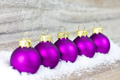 Xmas decoration with purple balls Royalty Free Stock Image