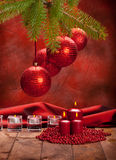 Xmas decoration - red balls and candles Stock Images