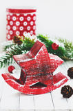 Xmas decoration with red wooden star, fir tree and cones. With copy space on white background Royalty Free Stock Images
