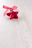 Xmas decoration star bow red Royalty Free Stock Photography