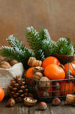 Xmas decoration with tangerines and nuts with copyspace on woode Stock Image