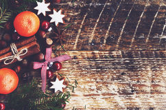 Xmas decoration with tangerines, spices, gingerbread cookies Royalty Free Stock Images
