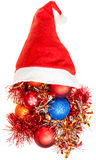 Xmas decoration tinsel spill out from santa hat Royalty Free Stock Image
