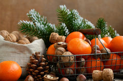 Xmas Decoration With Tangerines And Nuts With Copyspace On Wooden Backdrop Stock Photos