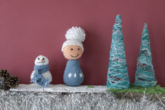 Free Xmas Decorations Crafts Fireplace Boy Snowmen Trees Stock Photo - 63440670