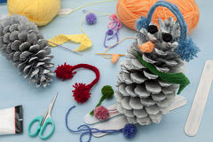 Xmas decorations crafts: pinecone. A horizontal frontal view of the creation of some xmas decorations by recycling some pinecone royalty free stock photos