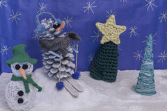 Xmas decorations crafts snow scenary skier snowman and trees Stock Images