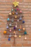 Xmas decorations crafts tree brick wall pompom Stock Images