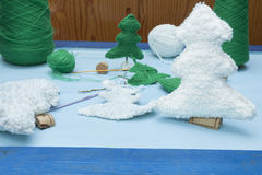 Xmas decorations crafts: white nad green crochet trees Royalty Free Stock Images