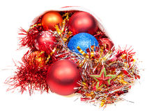 Xmas decorations fall out from red santa hat royalty free stock images