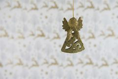 Christmas photography image christmas decoration hanging up of gold glitter angel with reindeer wrapping paper background Royalty Free Stock Photos
