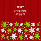 Xmas decorations on red knitted background Stock Images