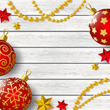 Xmas decorations on wood Royalty Free Stock Photos