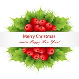 Xmas decoratoions with red holly berries and leaves Royalty Free Stock Photo